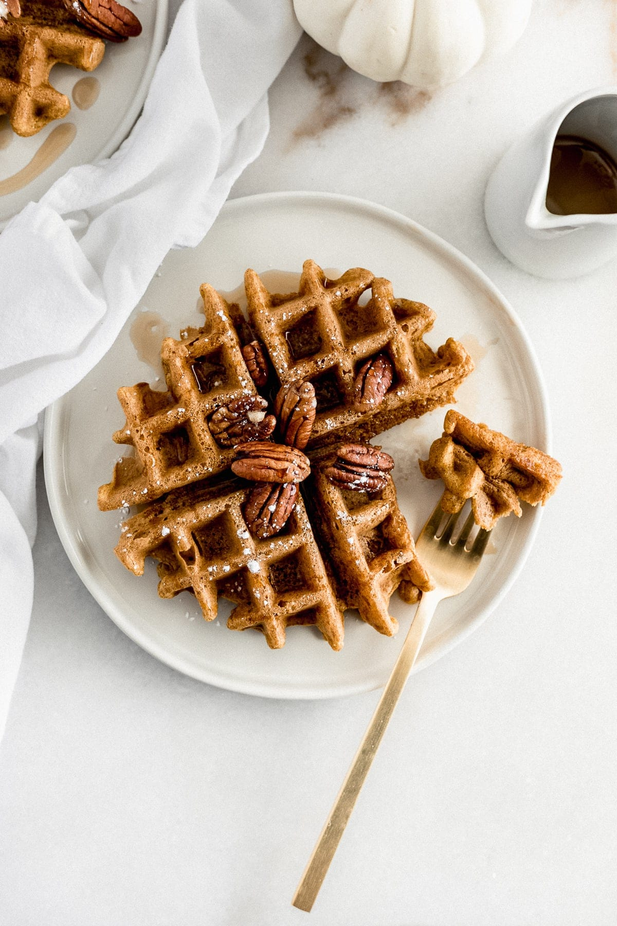 Healthy whole wheat pumpkin waffles with crispy outsides and fluffy, spiced insides are the perfect fall breakfast to wake up to on weekends!  (dairy-free, vegetarian, no added sugar)