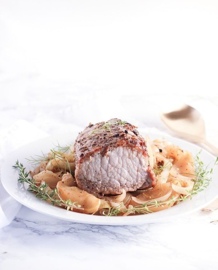 Pork loin with braised apples, onions and fennel is an easy and delicious fall meal you can make in just one pot in less than 45 minutes. (gluten-free, dairy-free)