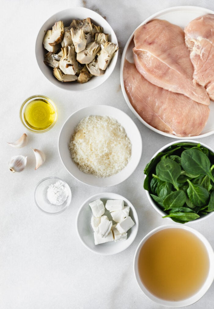 overhead view of ingredients needed to make spinach artichoke chicken.