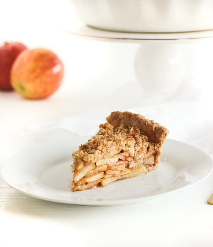 Apple crumb pie made with whole wheat flour, juicy apples, cinnamon, and a buttery crumb topping is perfect for all of your holiday celebrations!  (vegan option)