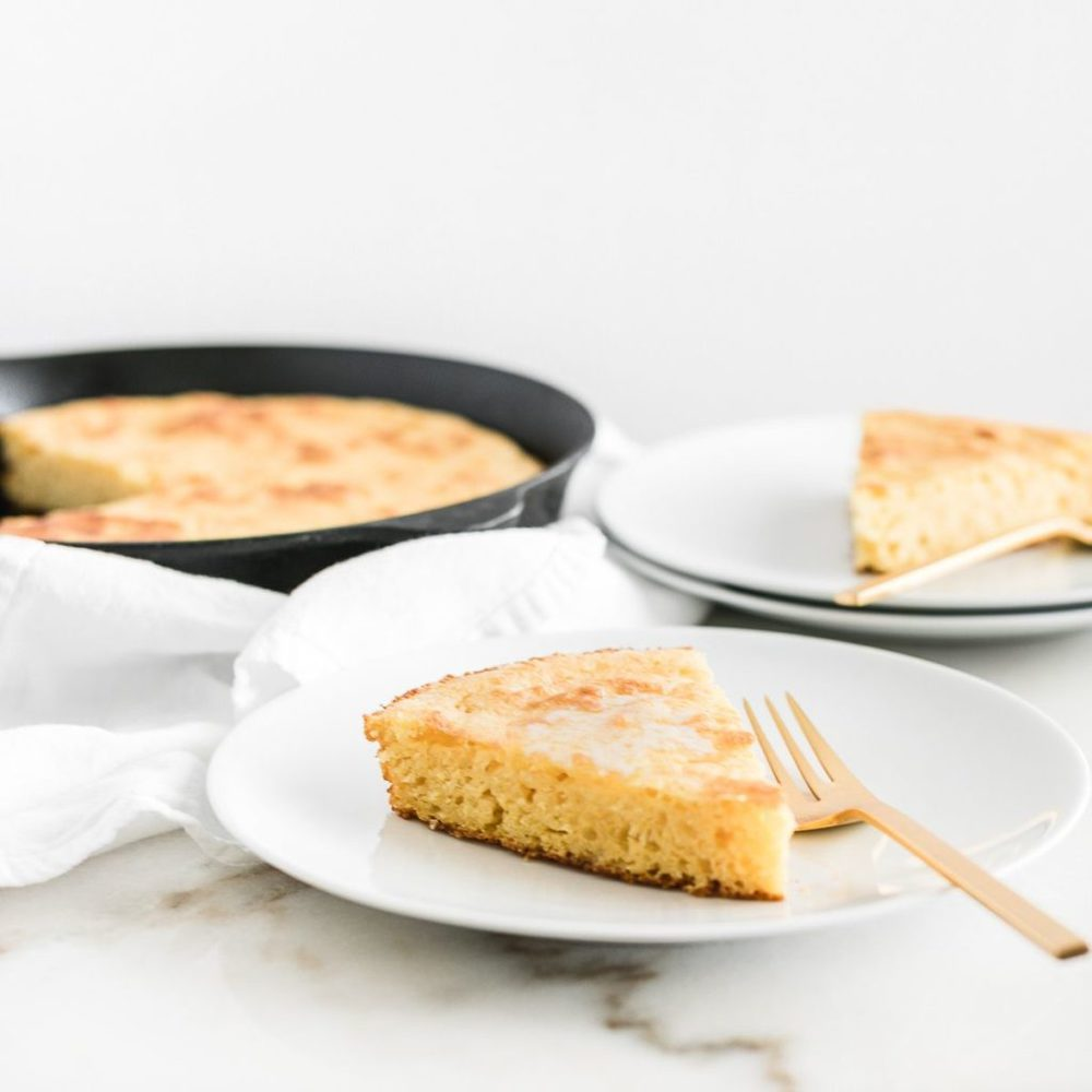 slice of skillet cornbread on a plate.