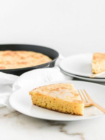 slice of skillet cornbread on a plate.
