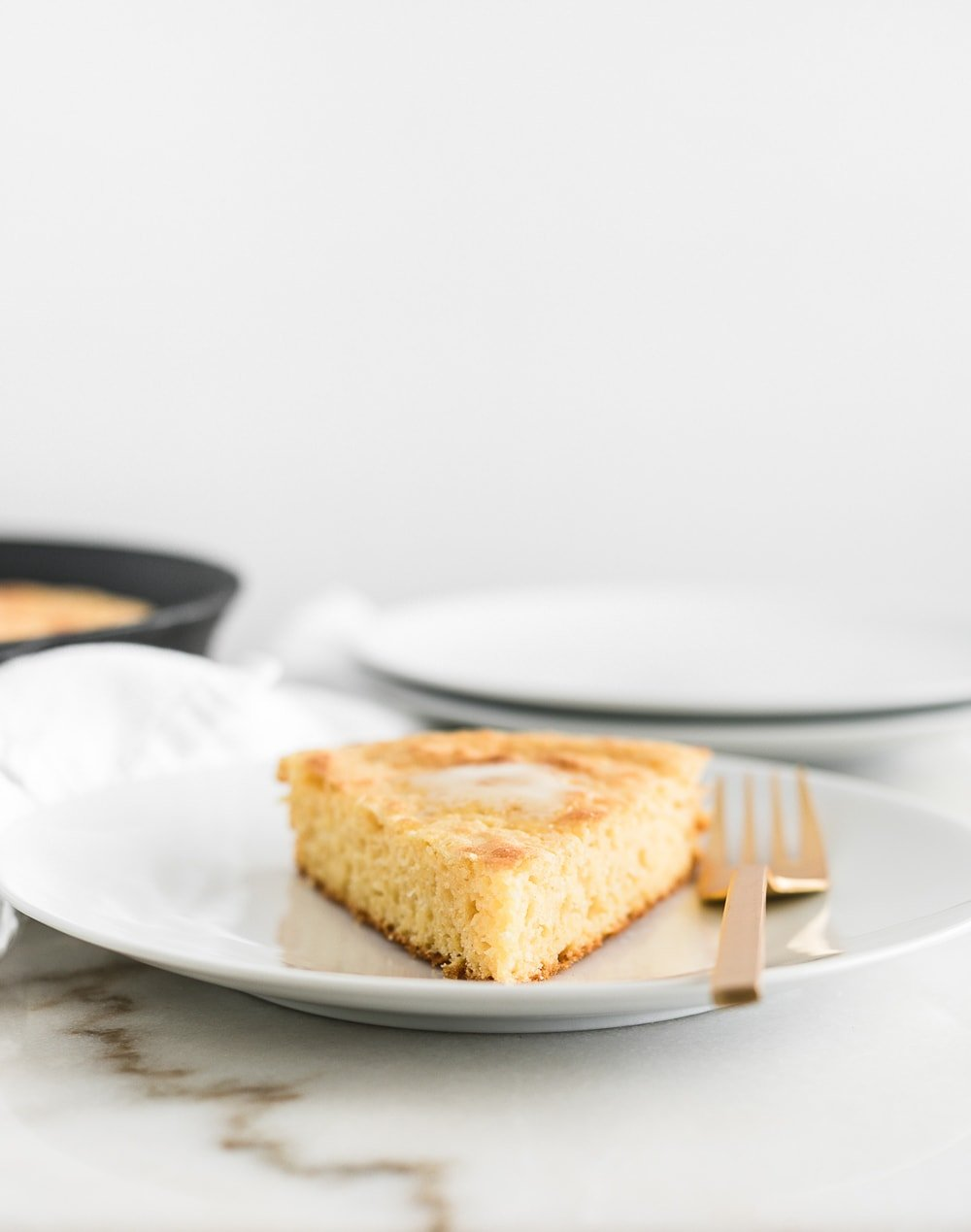This lightened up skillet cornbread is a must-have recipe for cold weather. It goes great with soups, beans, or in your Thanksgiving stuffing, and it's so simple to make! (vegetarian)