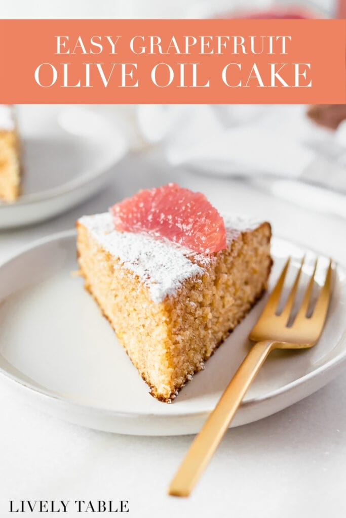 slice of grapefruit olive oil cake with a gold fork on a plate with text overlay.