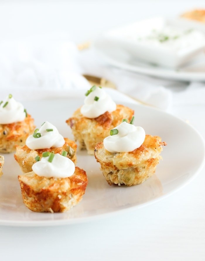 Healthier Loaded Mashed Potato Bites made with leftover mashed potatoes, chives, bacon, cheddar and Greek yogurt are a fun appetizer or side dish to change up your potato routine. (gluten-free)