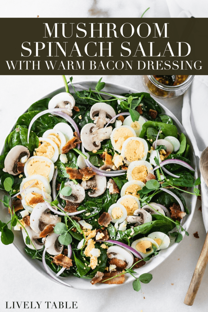 overhead view of mushroom spinach salad with warm bacon dressing with text overlay.