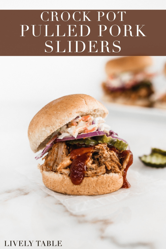 pulled pork slider with pickles, onion, coleslaw and barbecue sauce with text overlay.