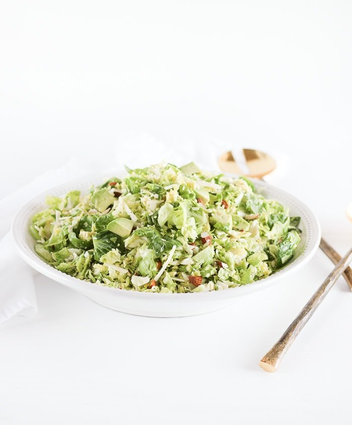 This healthy shaved brussels sprout salad with parmesan, almonds,avocado and a citrus shallot vinaigrette is the perfect hearty winter salad to go with all of your meals! (gluten-free, vegetarian)