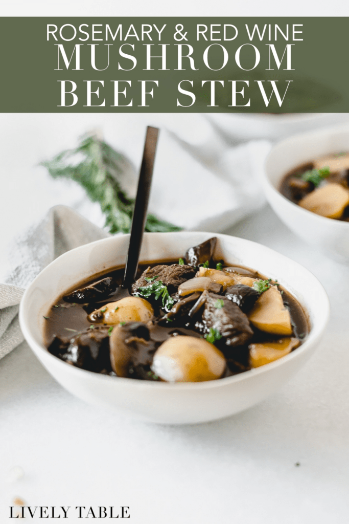 bowl of rosemary mushroom beef stew with a black spoon in it with text overlay.