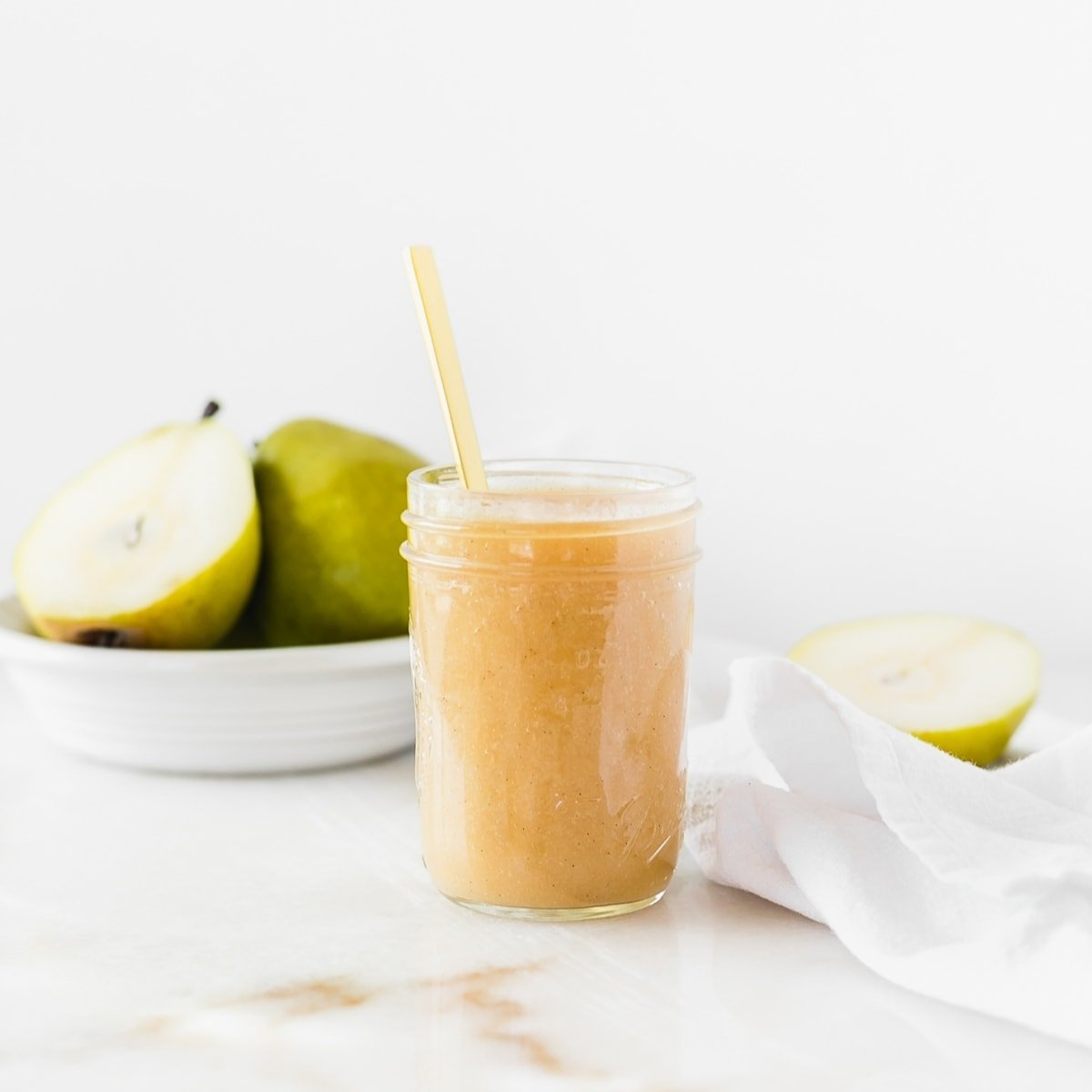 Naturally sweetened slow cooker vanilla bean pear butter is the perfect way to use up a bunch of pears! It's easy, low sugar and delicious with everything from oatmeal and pancakes to pork loin and cheese platters. (Includes canning instructions.) gluten-free, nut-free, dairy-free