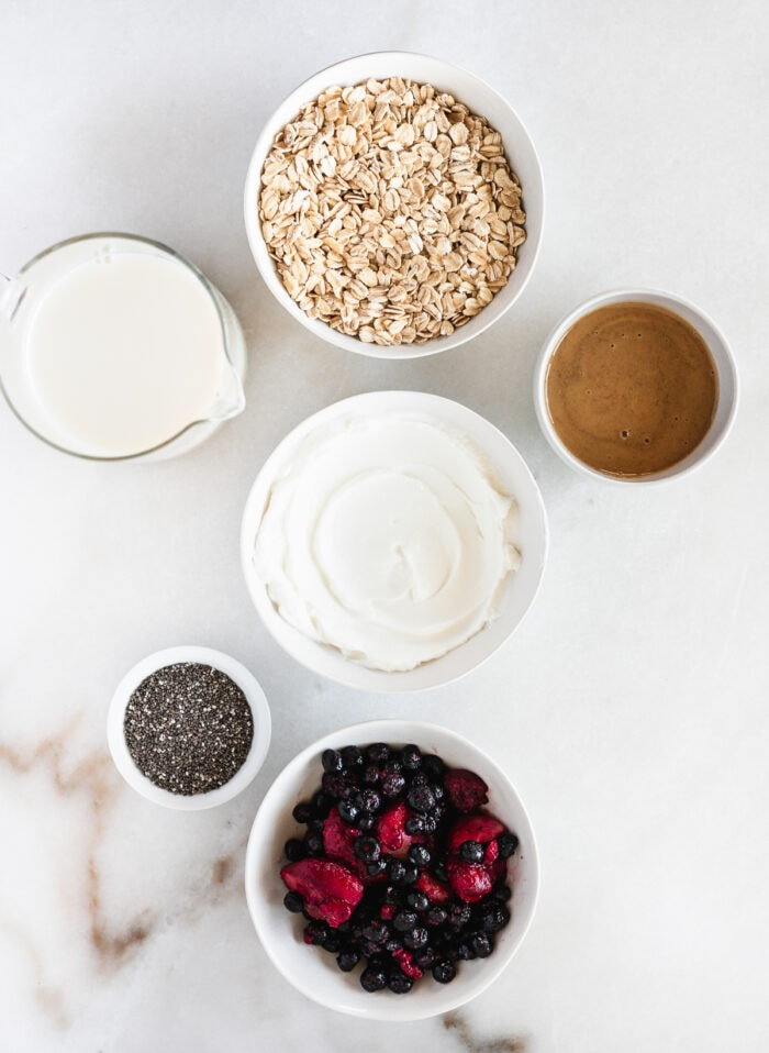 overhead view of ingredients needed to make pbj overnight oats.