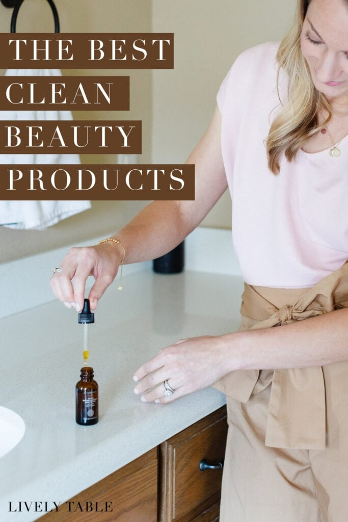 woman in a pink shirt pulling a dropper from a bottle of facial serum with text overlay.