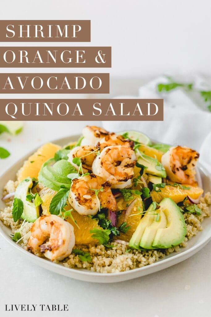 shrimp orange avocado quinoa salad on a grey plate with text overlay.