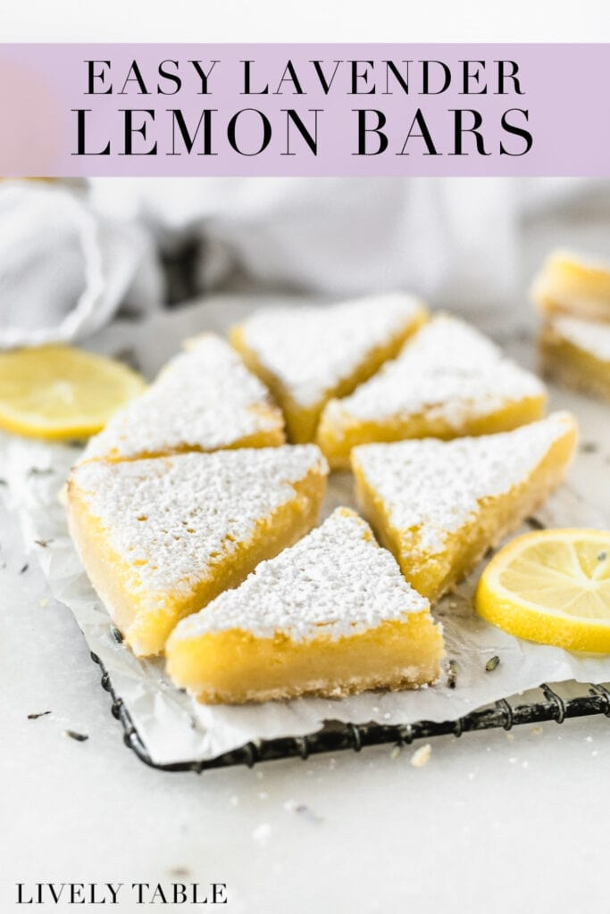 lavender lemon bars cut into triangles on a wire rack surrounded by lemon slices with text overlay.