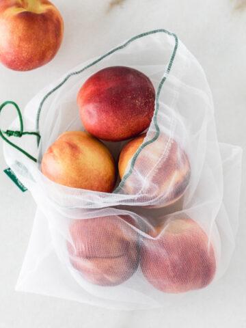 peaches in a mesh produce bag.