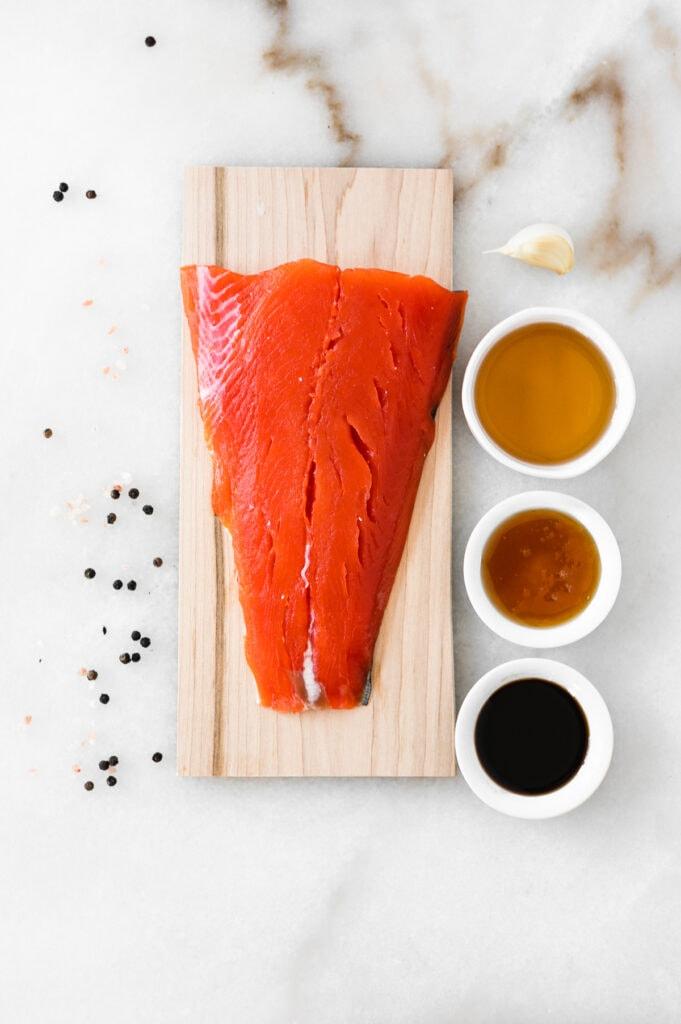 overhead view of ingredients needed to make bourbon glazed cedar plank salmon.