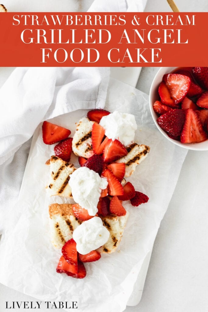 overhead view of 3 slices of grilled angel food cake topped with strawberries and whipped cream on a white serving platter with text overlay.