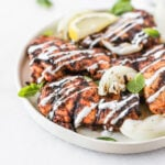 harissa grilled chicken thighs with lemon mint yogurt sauce