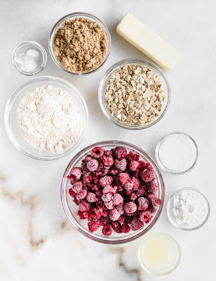 overhead view of ingredients needed for raspberry oat crumble bars.