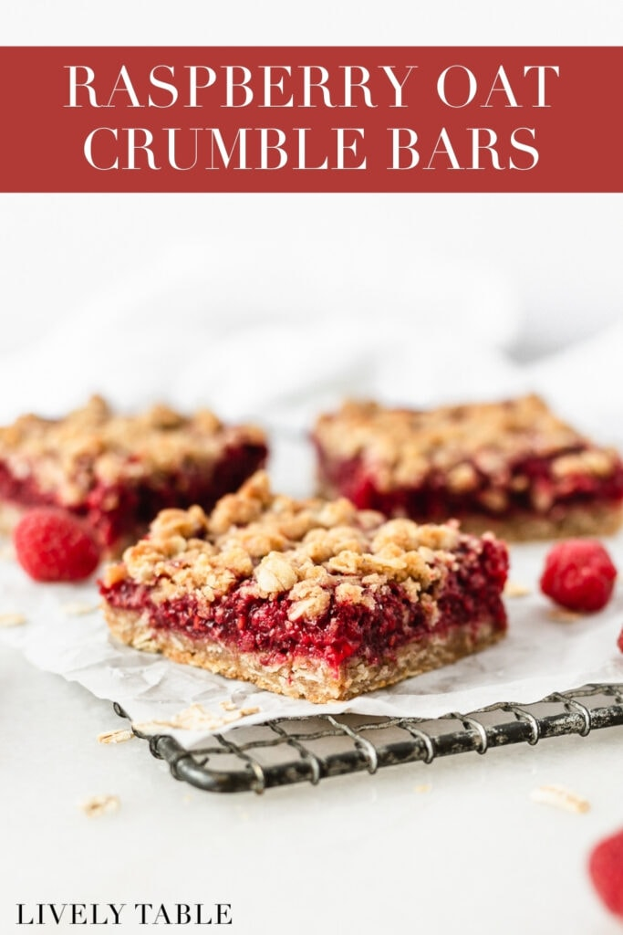 Raspberry Oat Crumble Bars on a wire cooling rack with oats and raspberries scattered around them with text overlay.