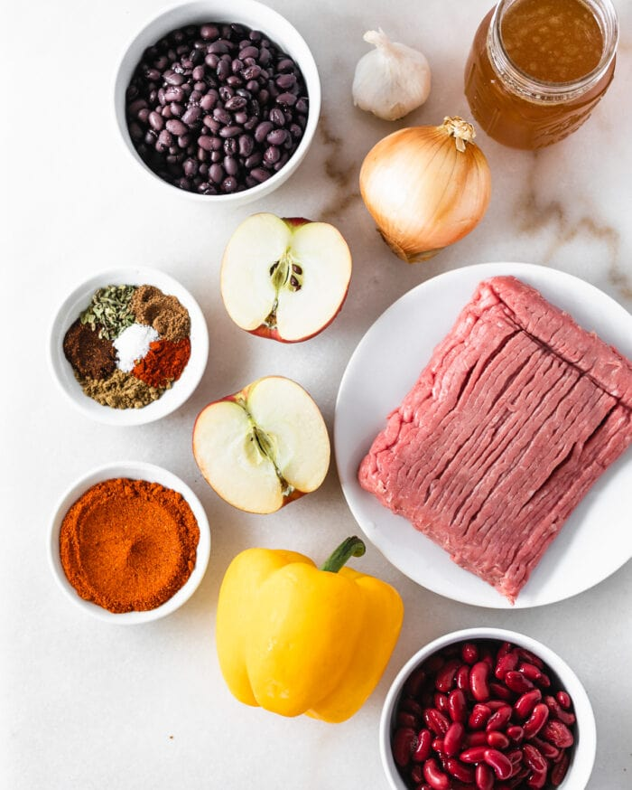 overhead view of ingredients needed to make chipotle apple turkey chili.