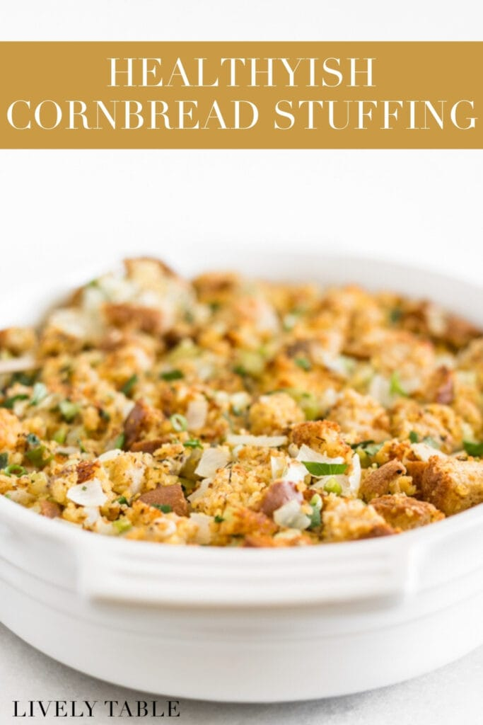 cornbread stuffing in a white oval baking dish wish text overlay.