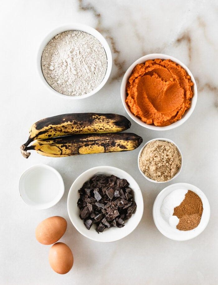 overhead view of ingredients needed to make chocolate chunk pumpkin banana bread.