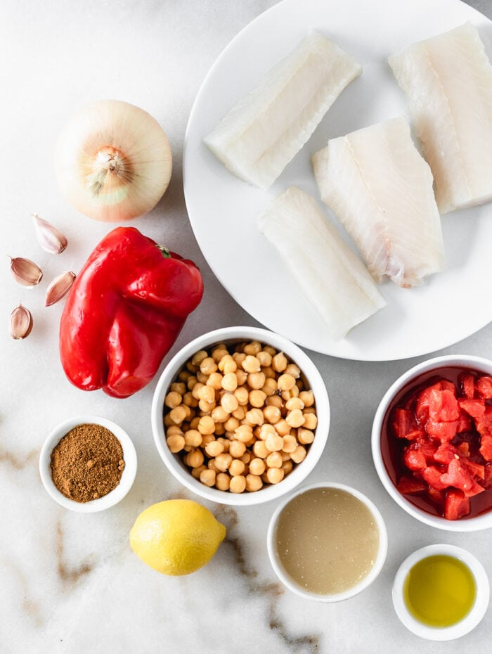 overhead view of ingredients needed to make moroccan cod and chickpea skillet.