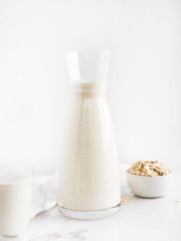 oat milk in a glass carafe.