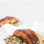 Looking to add more seafood to your diet? This heart-healthy harissa glazed Alaska salmon with lemon mint quinoa is a delicious, healthy way to switch up your weeknight dinner routine! It's full of flavor and ready in less than 30 minutes. (gluten-free, dairy-free, nut-free) #ad #AskforAlaska #hearthealth #seafood #salmon #healthy #dinner #recipes #30minutemeals
