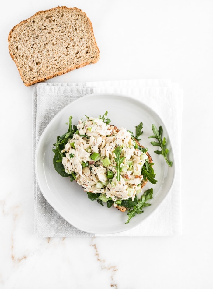 no mayo orange poppy seed chicken salad on a slice of bread