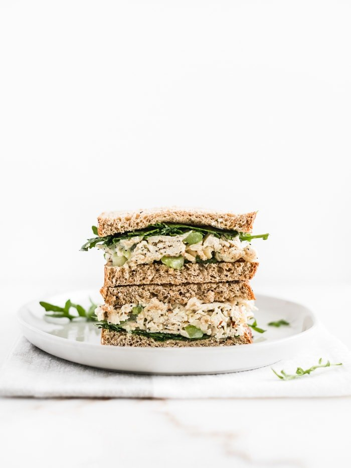 no mayo orange poppy seed chicken salad sandwich cut in half and stacked
