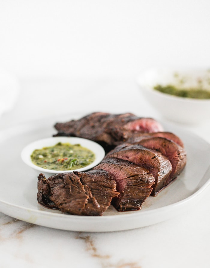 Easy seared venison tenderloin with chimichurri sauce is a healthy, delicious dinner! #maindish #venison #chimichurri #healthy #dinner