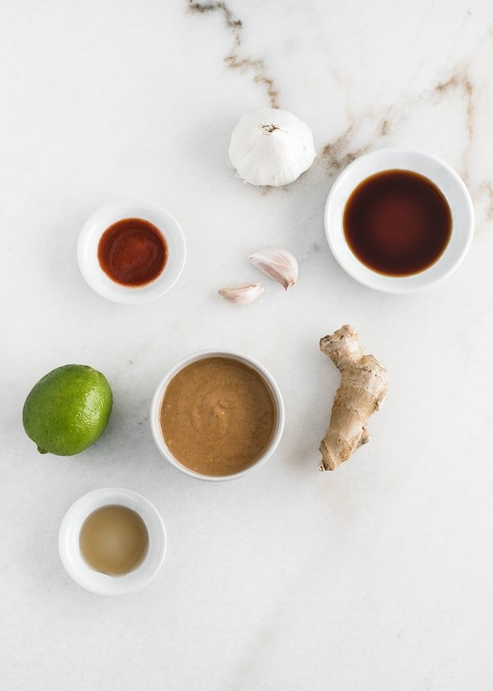 all purpose thai peanut sauce ingredients on a white background.