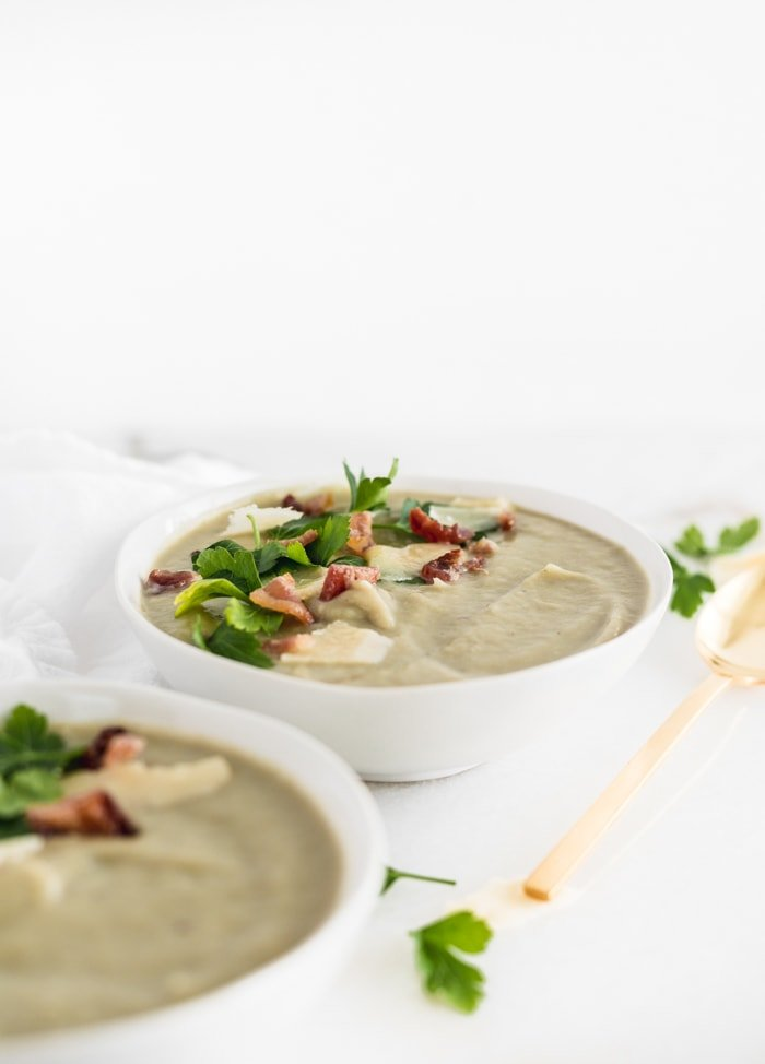 creamy artichoke white bean soup topped with bacon, parmesan and parsley