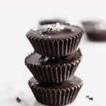 Satisfy your sweet tooth with these delicious salted dark chocolate tahini cups. They're a grown up version of your favorite peanut butter and chocolate candy - less sweet and perfect for an after dinner treat! (#glutenfree, #nutfree, #dairyfree and #vegan options) #darkchocolate #tahini #dessert #salted #recipes
