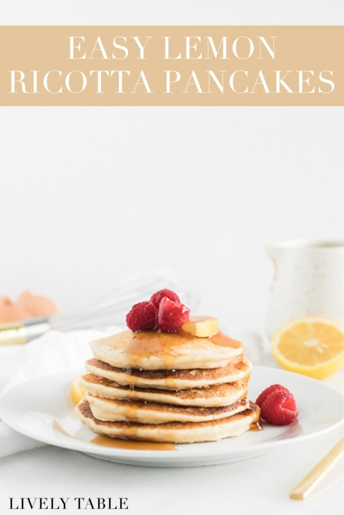 stack of lemon ricotta pancakes with raspberries and syrup on top with text overlay.
