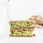 smashed chickpea avocado salad sandwich on whole grain bread