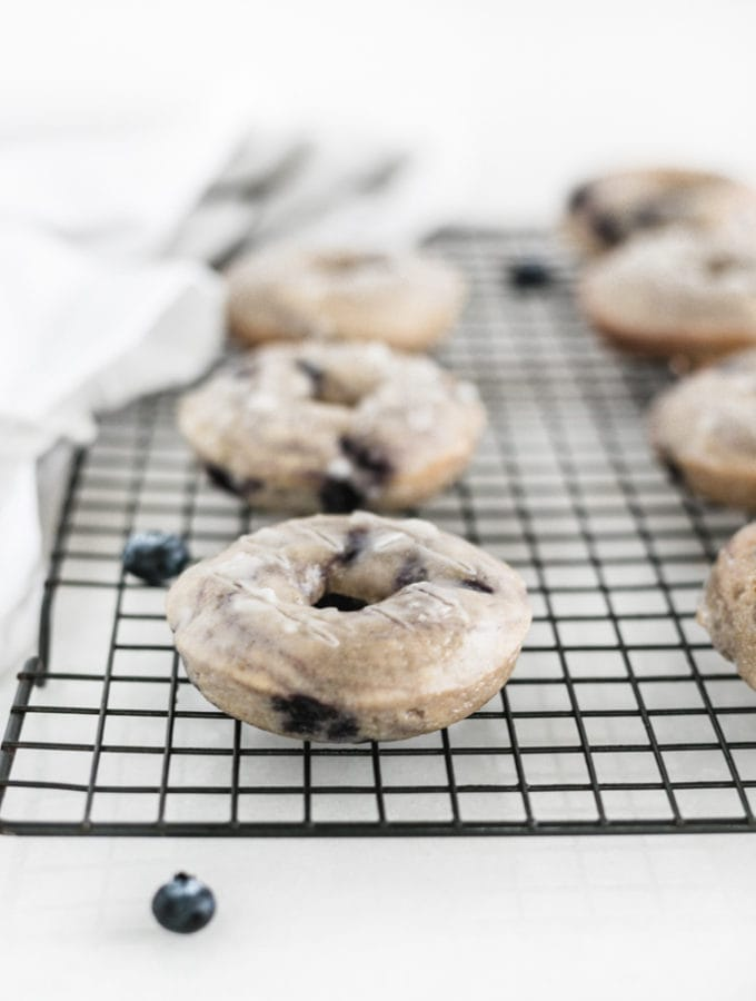 blueberry baked donuts on cooling rack
