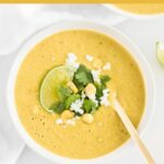 This creamy roasted poblano corn soup is a little sweet, and little spicy and absolutely delicious year round! Make it with fresh corn in the summer, or use canned or frozen corn in winter months. (#glutenfree, #nutfree, #vegetarian, #vegan option) #corn #summer #poblano #soup #recipes #healthy