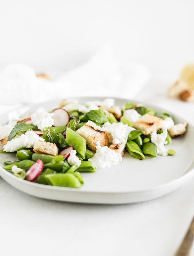 snap pea salad with burrata, sourdough croutons, and lemon vinaigrette