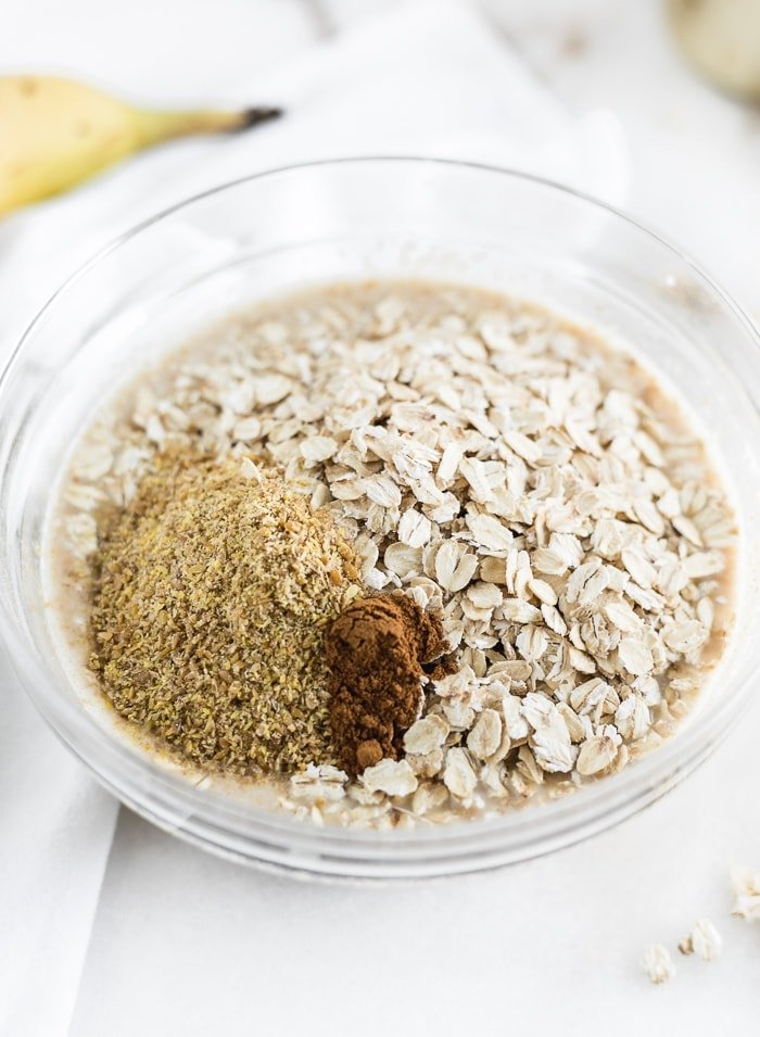 a bowl with oats, flaxseed, and cinnamon
