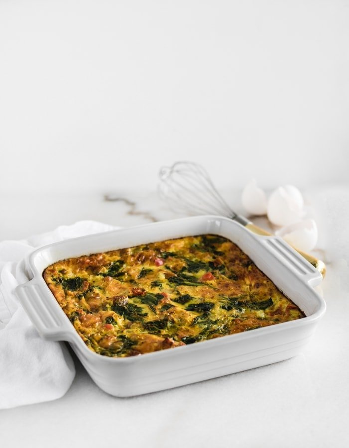 sweet potato veggie breakfast casserole in a white square dish