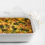 veggie sweet potato casserole in a white square caking dish