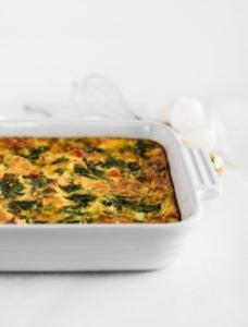 veggie sweet potato casserole in a white square caking dish