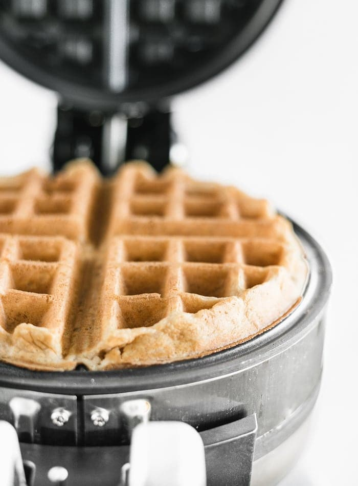 baked whole wheat waffle in a waffle iron.