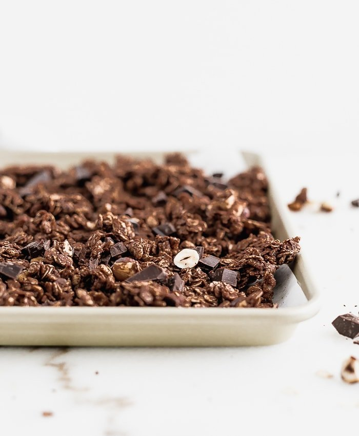 chunky chocolate hazelnut granola on a baking sheet.