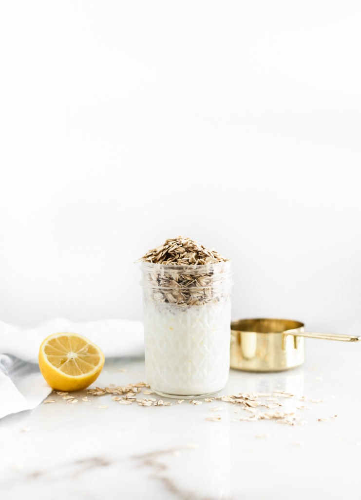 liquid ingredients in a glass jar with oats on the top.