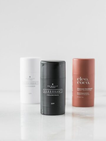 three natural deodorants against a white background.