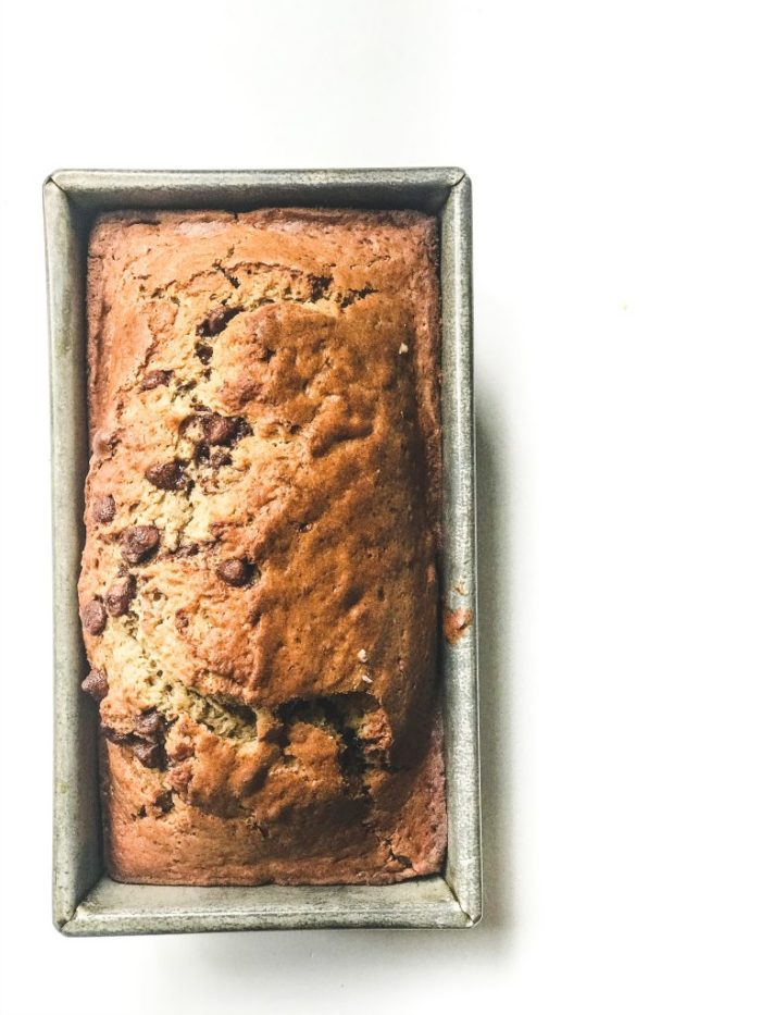 overhead view of sourdough banana bread in a loaf pan.